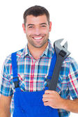 Male repairman holding adjustable wrench — Stock Photo