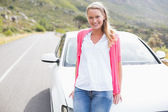 Pretty blonde leaning on the bonnet  — Stock Photo