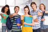 College students gesturing thumbs up — Stock Photo