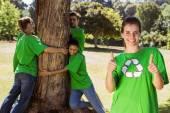 Environmental activists hugging tree — Stock Photo