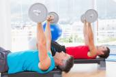Men lifting barbell — Stock Photo
