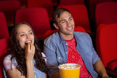 Young couple watching a film — Stock Photo