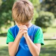 Little boy saying his prayers — Stock Photo #69000541