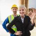 Happy businesswoman making okay gesture — Stock Photo #69001009