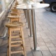 Bar stool and tables on terrace — Stock Photo #69001179