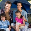 Happy family on a camping trip in their tent — Stock Photo #69001525