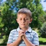 Little boy saying his prayers — Stock Photo #69001565