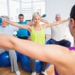 People working out with dumbbells in fitness club — Stock Photo #69001621