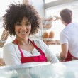 Waitress posing with arms crossed — Stock Photo #69001769