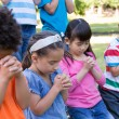 Children saying their prayers in park — Stock Photo #69002513