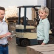 Two warehouse managers checking inventory — Stock Photo #69002537