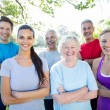 Happy athletic group with arms crossed  — Stock Photo #69002625
