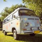 Retro camper van in a field — Stock Photo #69003787