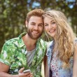 Young couple relaxing on park bench — Stock Photo #69004681
