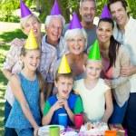 Happy family celebrating a birthday — Stock Photo #69005031