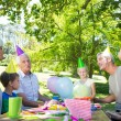 Happy family celebrating a birthday — Stock Photo #69005037