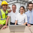 Warehouse managers and worker smiling — Stock Photo #69006229