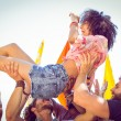 Happy hipster woman crowd surfing — Stock Photo #69006709