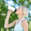 Pretty blonde drinking up water — Stock Photo #69007187