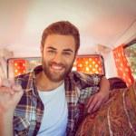 Hipster on road trip in camper van — Stock Photo #69007347