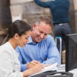 Warehouse team working together with clipboard — Stock Photo #69008829