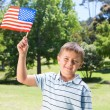 Little boy waving american flag — Stock Photo #69008975