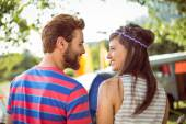 Hipster couple smiling at each other — Stock Photo