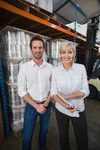 Warehouse managers looking at camera — Stock Photo