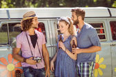 Hipster friends chatting and drinking — Stock Photo