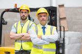 Manager with arms crossed and his colleague — Stock Photo
