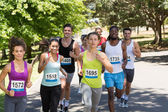Happy people running race in park — Stock Photo