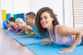 Woman with friends practicing push-ups — Stock Photo