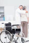 Doctor assisting senior woman — Stock Photo