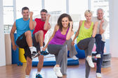 People performing aerobics exercise in gym class — Stock Photo