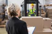 Warehouse manager in front of colleague — Stock Photo