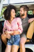 Hipster couple in camper van — Stock Photo