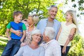Happy family talking in the park — Stock Photo