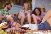 Happy hipsters relaxing on the campsite — Stock Photo