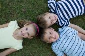 Happy siblings smiling at camera together — Stock Photo