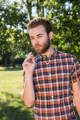 Hipster smoking an electronic cigarette — Stock Photo