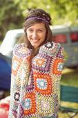 Hipster wrapped in crotchet blanket — Stock Photo