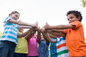 Children putting thumbs up together — Stock Photo