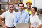 Warehouse managers and worker smiling — Stock Photo