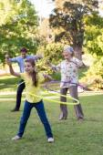 Extended family playing with hula hoops — Stock Photo