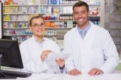 Team of pharmacists looking at paper — Stock Photo
