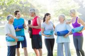 Happy athletic group talking — Stock Photo