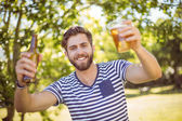 Hipster having himself a beer — Stock Photo