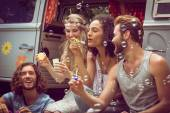 Hipsters blowing bubbles in camper van — Stock Photo