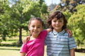 Little siblings smiling at camera — Stock Photo