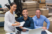 Smiling warehouse managers working together — Stock Photo